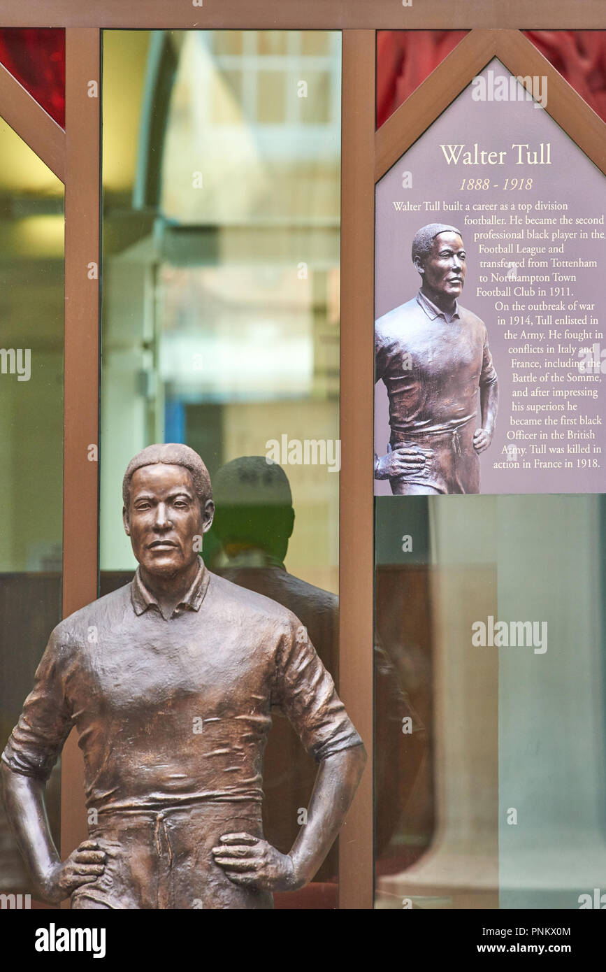 Metal statue and biography of Walter Tull, black footballer, in the courtyard at the Guildhall, offices of Northampton town Council, England. - Stock Image