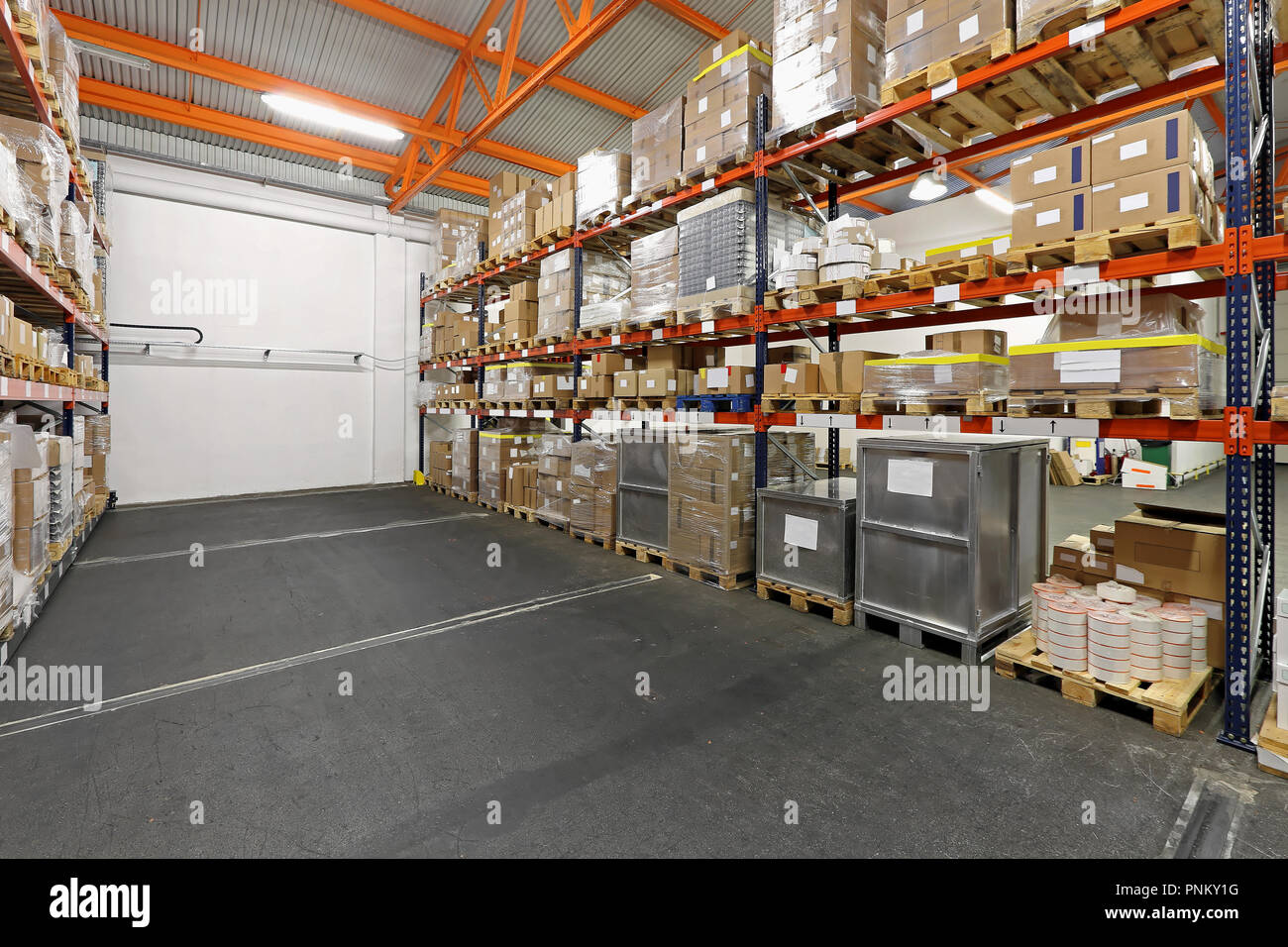 Shelves loaded with merchandise in wholesale warehouse Stock
