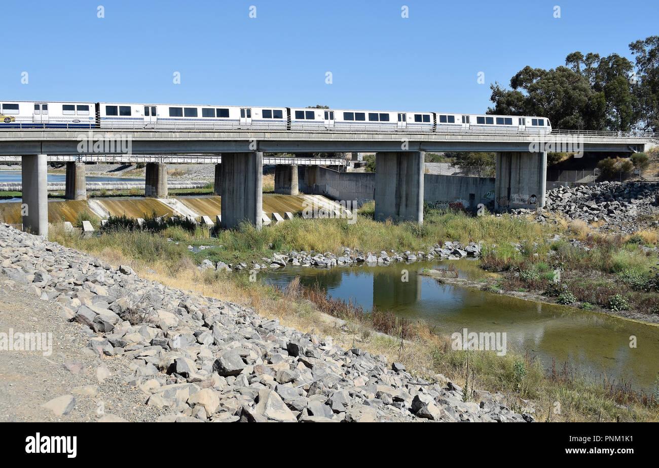 moving BART train on trestle over Alameda Creek, Fremont, California, September, - Stock Image