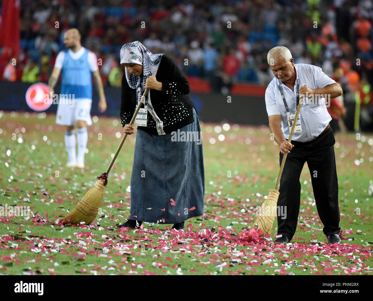 Trabzon, Turkey - September 7, 2018. Workers cleaning up confetti from pitch during half-time break in UEFA Nations League match Turkey vs Russia in T - Stock Image