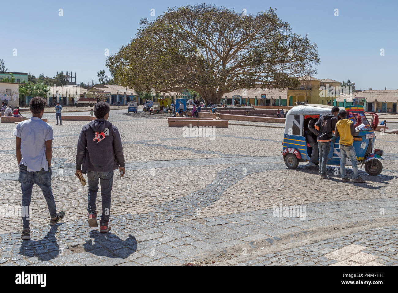 Streets of Axum - central market - main square - old bus station with Tut-tuts known locally as Baja - Stock Image