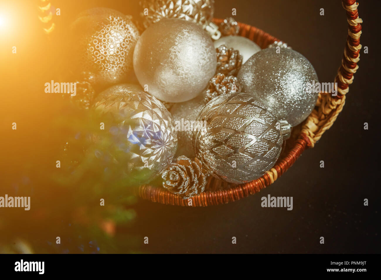 christmas new year composition with silver balls and pine cones in basket on black background xmas holiday december decoration to russian tradition