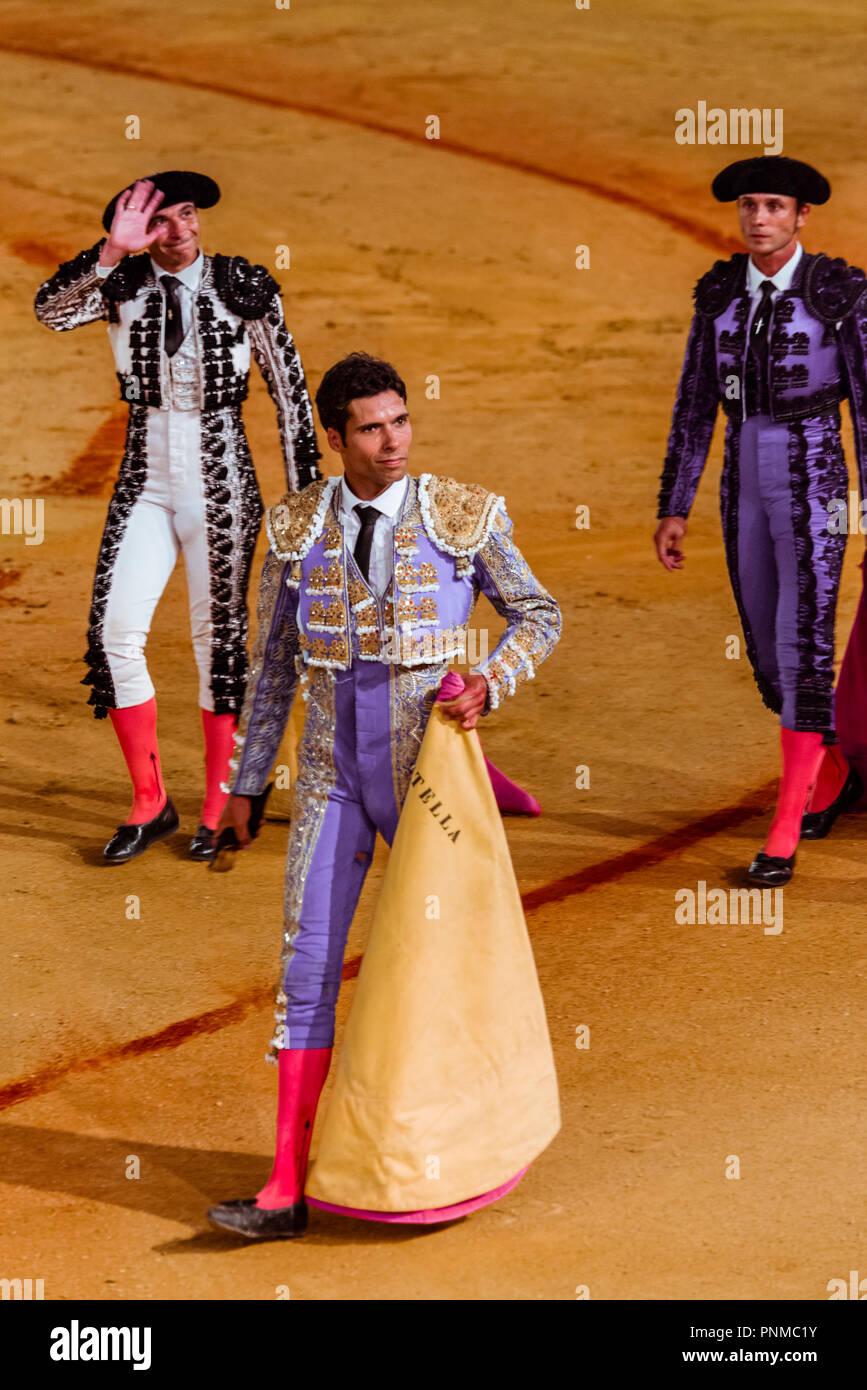 Matador, Torero or Toureiro in traditional clothing, bullfight, bullring Plaza de Toros de la Real de Maestranza de Caballería - Stock Image