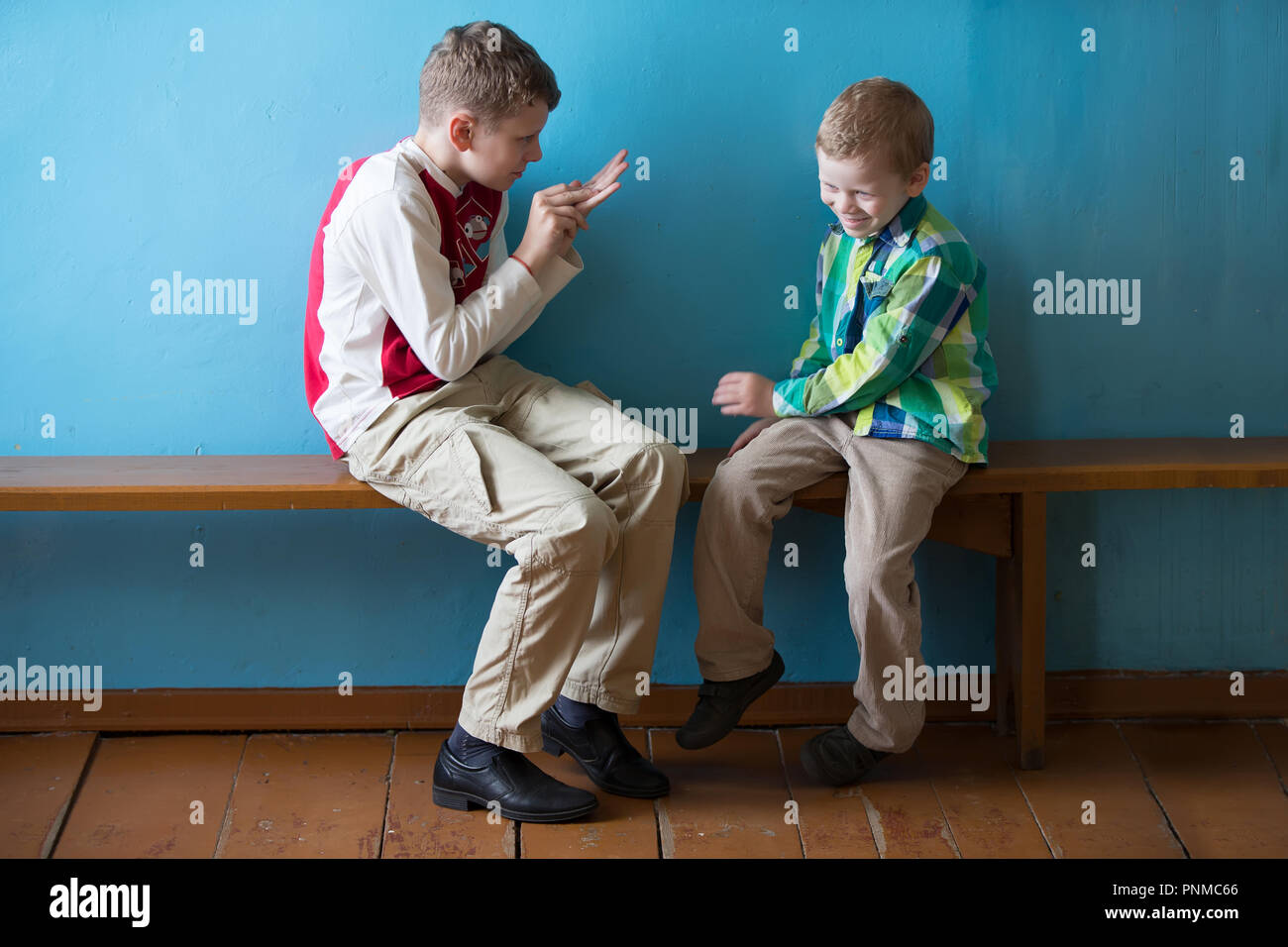 Belarus, Gomel, on July 2, 2018. Zyabrovskaya Church.Two Russian school-age boys are talking.The elder brother and younger brother - Stock Image