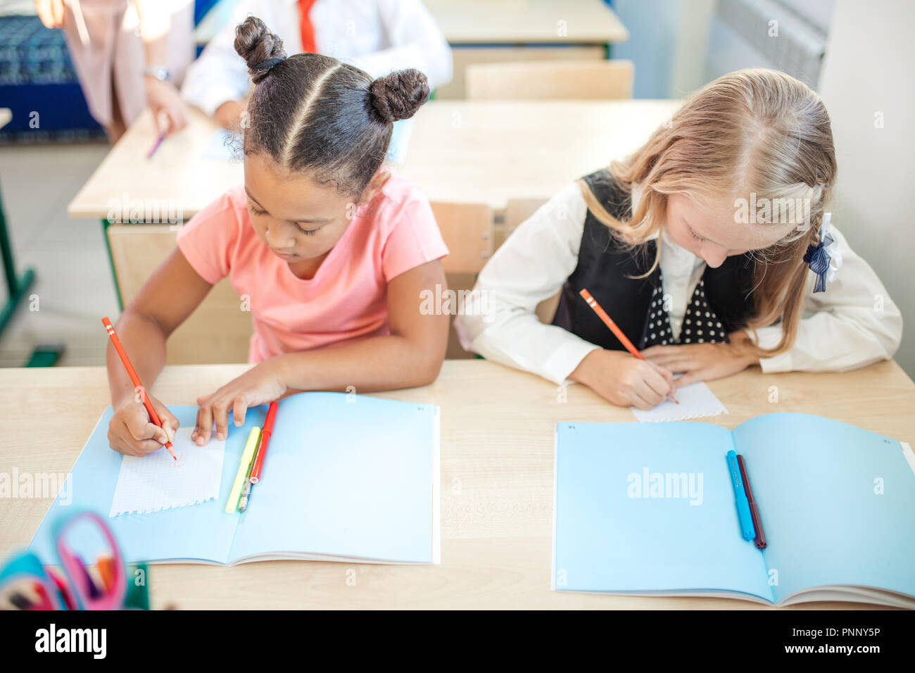 school children are participating actively in class. Education, homework concept - Stock Image