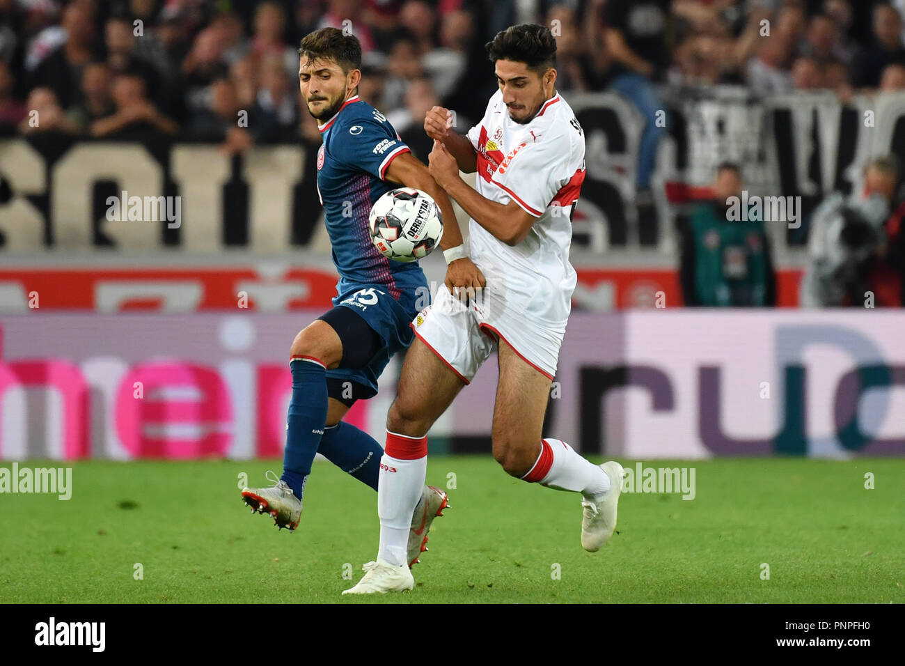 Stuttgart, Germany. 21st Sep, 2018.  Matthias ZIMMERMANN (Fortuna Dusseldorf), action, duels versus Berkay OEZCAN (VfB Stuttgart), touches his genitals, Soccer 1. Bundesliga, 4.matchday, matchday04, VFB Stuttgart (S) -Fortuna Dusseldorf (D) 0-0, on 21.09.2018 in Stuttgart/Germany. MERCEDES BENZ ARENA. DFL REGULATIONS PROHIBIT ANY USE OF PHOTOGRAPH AS IMAGE SEQUENCES AND/OR QUASI VIDEO. | usage worldwide Credit: dpa/Alamy Live News Credit: dpa picture alliance/Alamy Live News - Stock Image