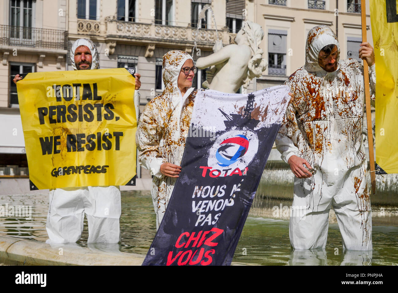 Lyon, France, september 22nd 2018: As part of a national Day of action organized by Greenpeace France and ANV-Cop21 (Non-Violent Action Cop21), a group of environmental defense activists occupy Jacobins fountain in Lyon (Central-Eastern France) on september 22, 2018, to protest against the suspected destruction of the Amazonian reef due to the fossil energy exploitation by Total Petroleum company. Credit Photo: Serge Mouraret/Alamy Live News - Stock Image