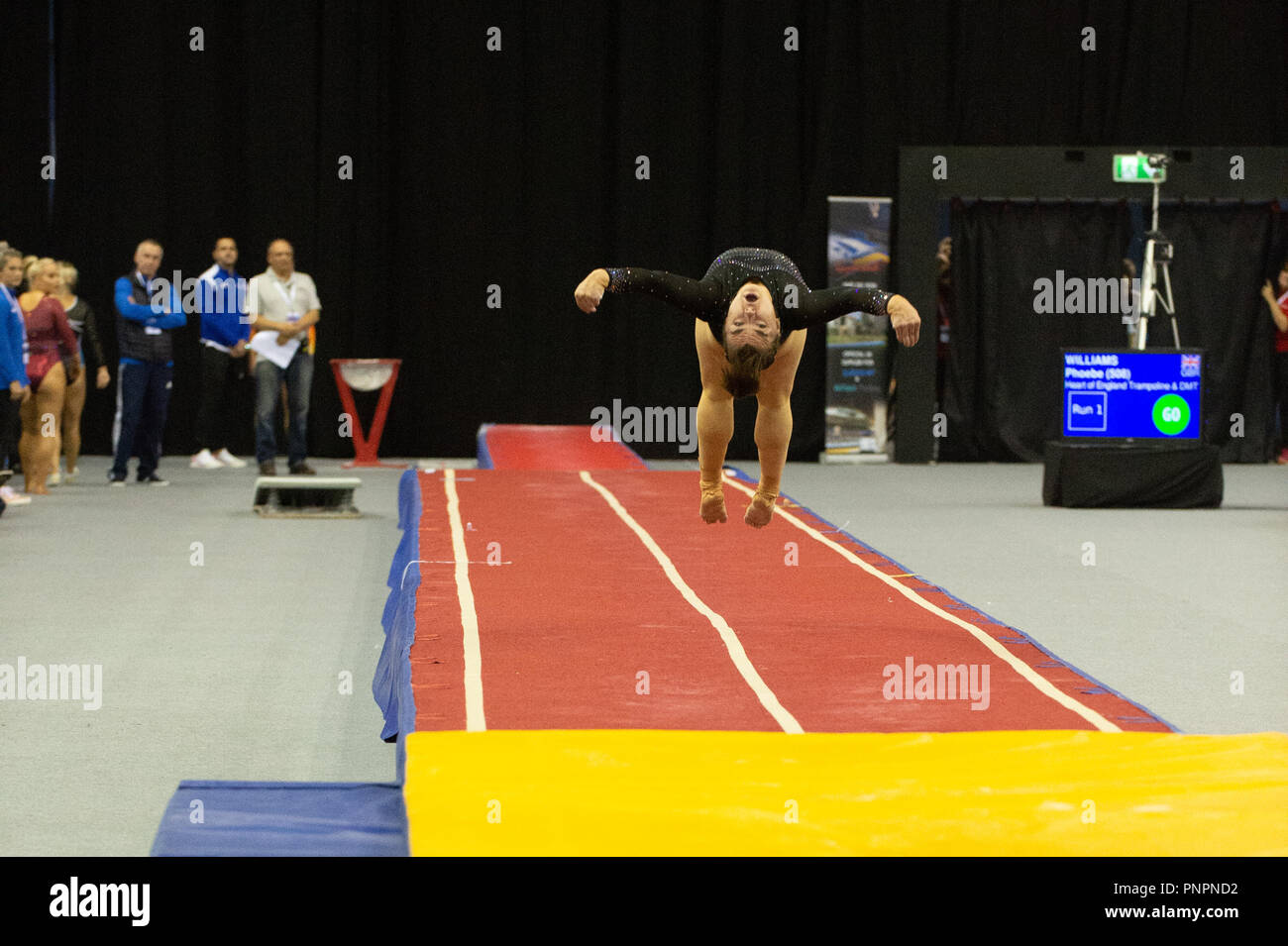 Birmingham, UK. 22nd September 2018. Megan Kealy, Milton Keynes Gymnastics completing a pass during British Gymnastics Trampoline, DMT and Tumbling British Championships 2018 at the Arena Birmingham, Birmingham, UK. Credit: Iain Scott Photography/Alamy Live News - Stock Image