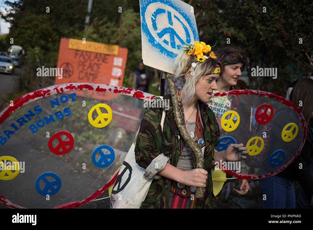 Faslane, Scotland, on 22 September 2018. 'Nae (No) Nukes Anywhere' anti-nuclear weapons demonstration at the Faslane Peace Camp and walking to a rally outside HM Naval Base Clyde, home to the core of the UK's Submarine Service, in protest against Trident nuclear missiles. The rally was attended by peace protestors from across the UK who came 'to highlight the strength of support from many UN member states for Scotland, a country hosting nuclear weapons against its wishes'. Photo Credit Jeremy Sutton-Hibbert/ Alamy News. - Stock Image