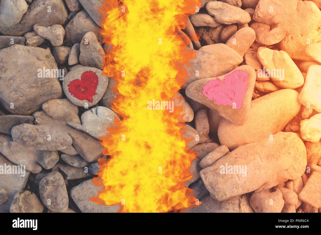 Cutting fire diving pink heart painted with lipstick on piece of stone. Symbol of the end of love and of two people break up and divorce - Stock Image
