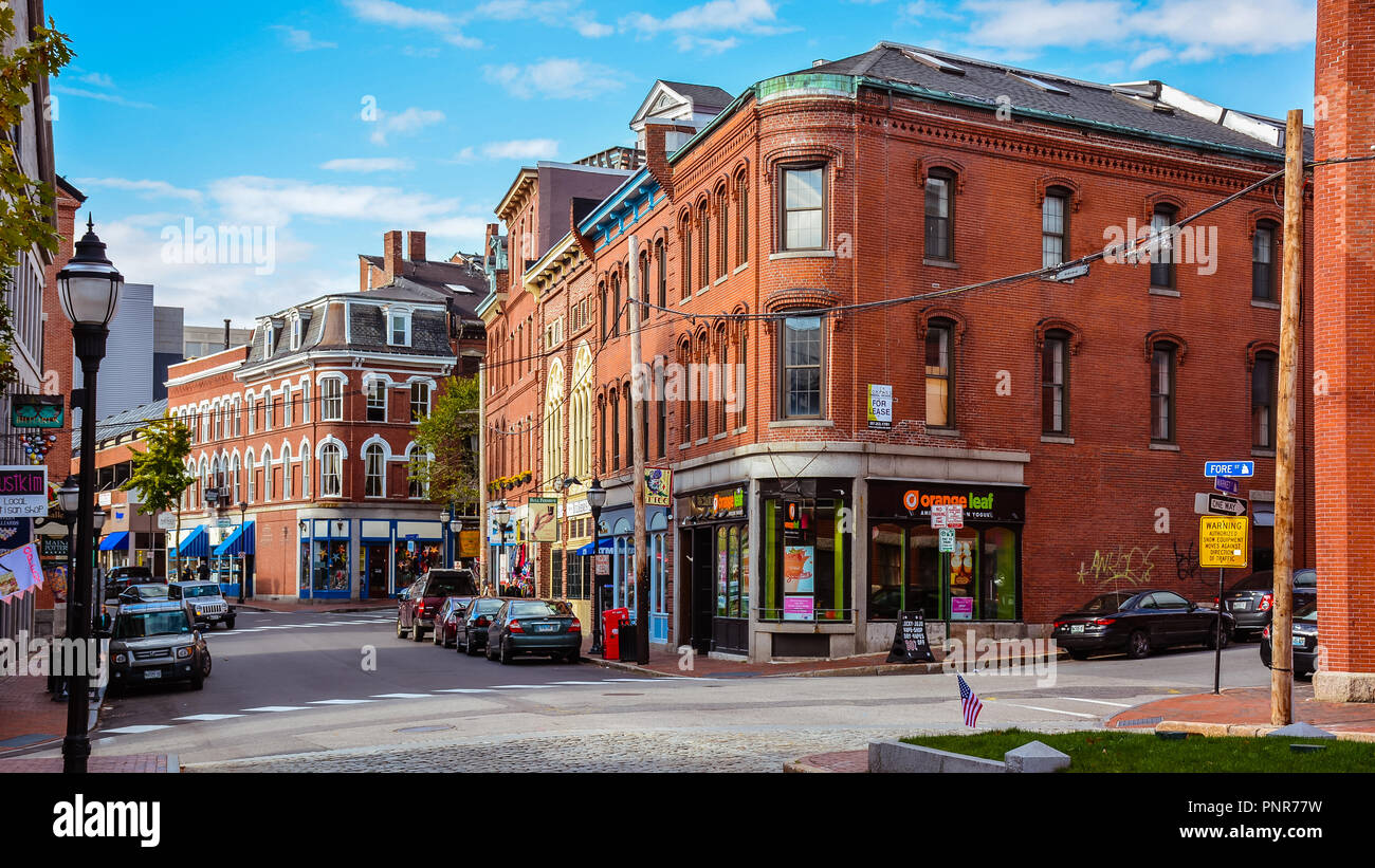 Corner of Fore & Market Sts. of Historical Old Port, a district of Portland, Maine, known for its cobblestone streets, 19th century brick buildings. - Stock Image
