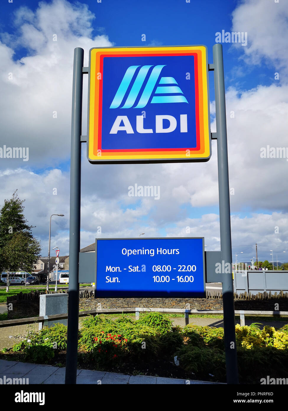 Swansea, UK: September, 2018: Commercial sign of ALDI Store against a blue sky with white cloud. ALDI is the common brand of two German discount store Stock Photo