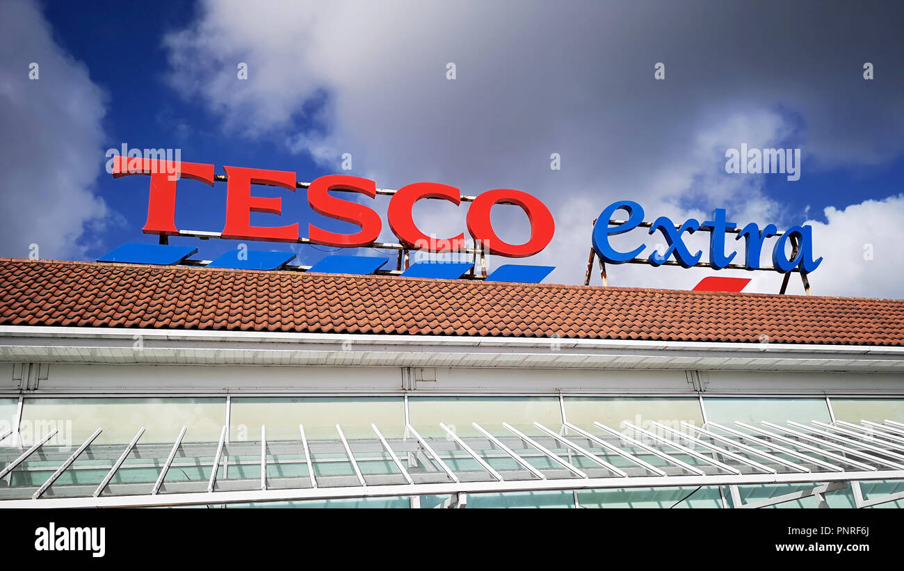 Llanelli, UK: September, 2018: Commercial signage of a Tesco Extra superstore. Tesco is a British multinational grocery and general merchandise retail - Stock Image