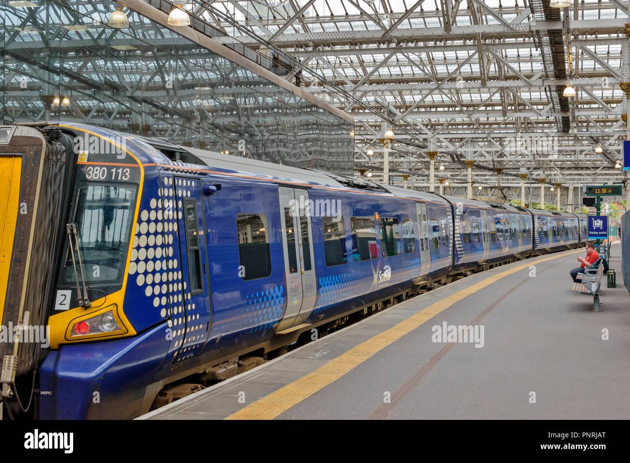 EDINBURGH SCOTLAND WAVERLEY STATION BLUE CARRIAGES OF SCOT RAIL TRAIN - Stock Image