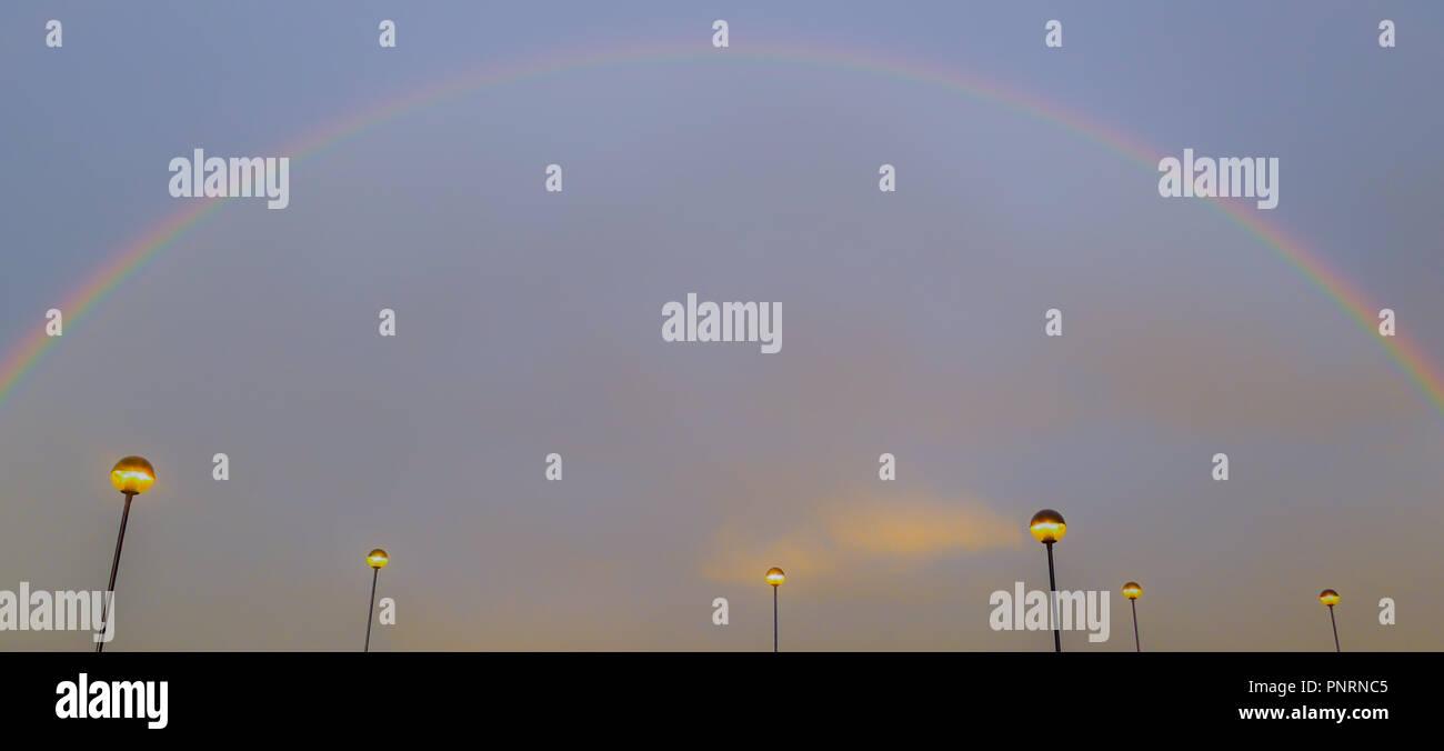 Car park with rainbow, futuristic look - Stock Image