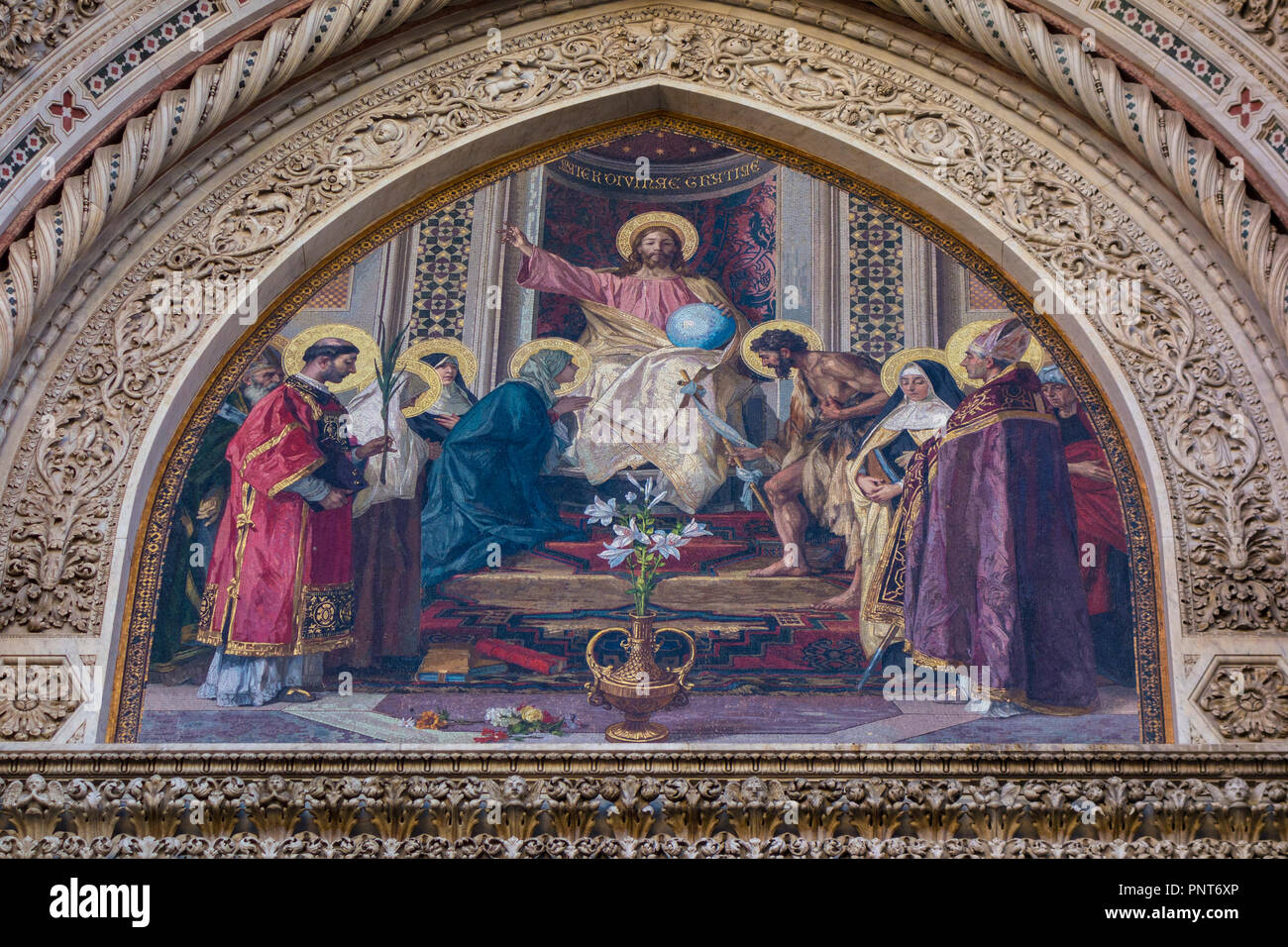 Mosaic showing Christ on the throne with the Virgin Mary and Saint John the Baptist at either side of him plus other saints, Florence Cathedral, Italy - Stock Image