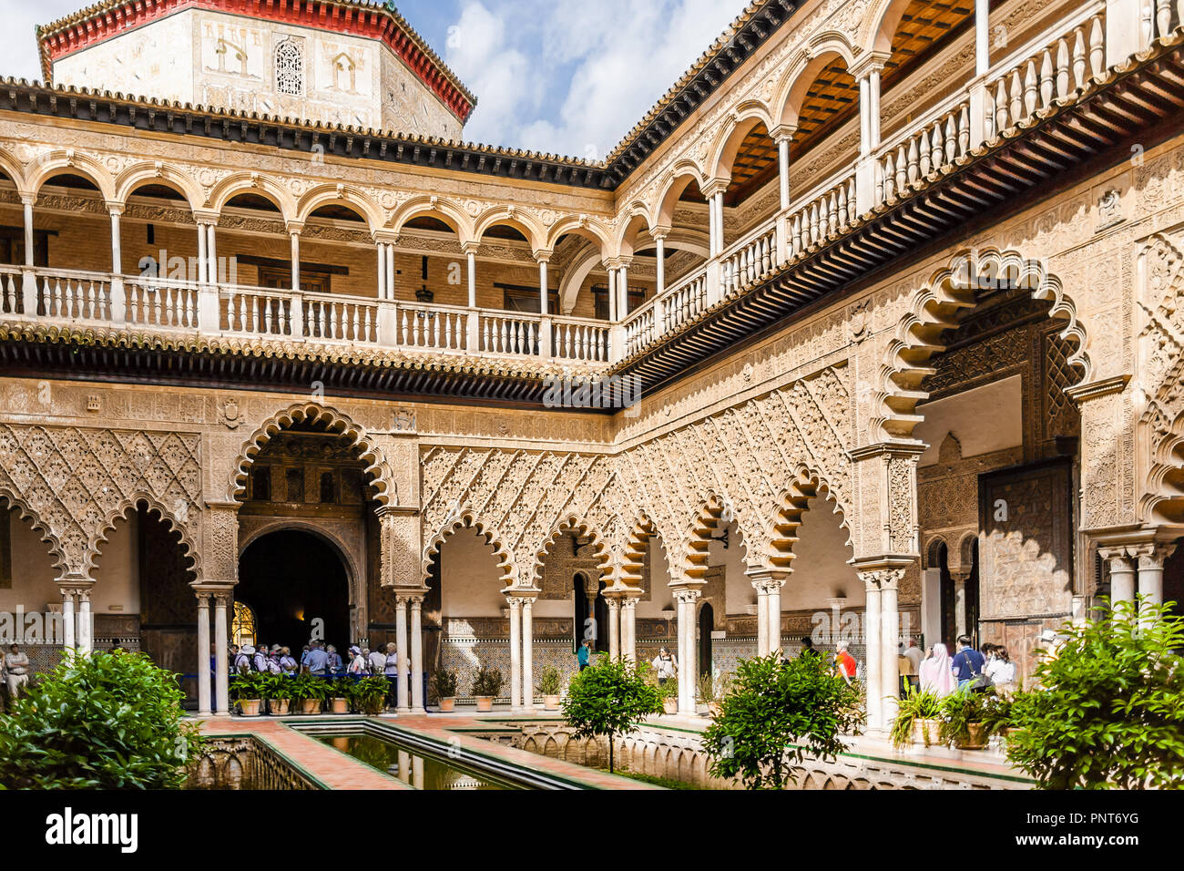 View of the ornate decoration in the inner courtyard of the Reales Alcazares, Seville, Spain. Stock Photo