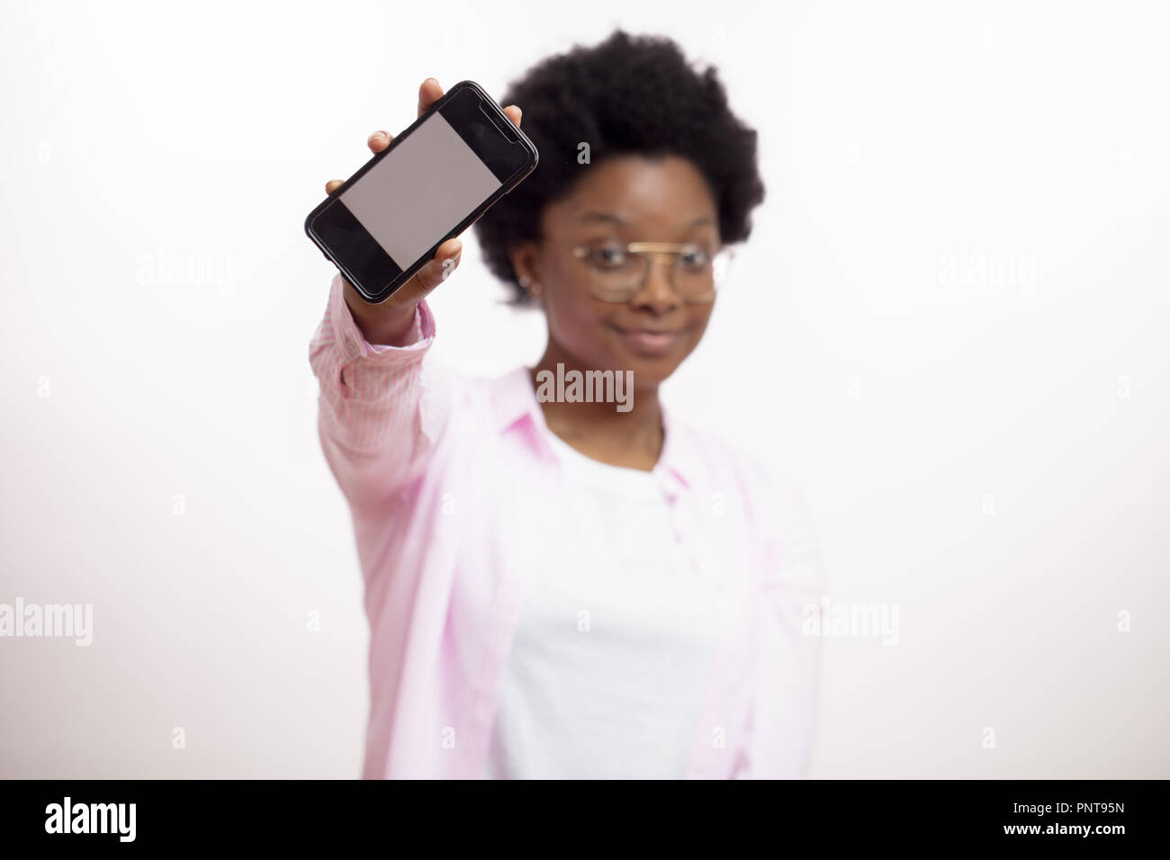 satisfied happy attractive african woman showing the screen mobile phone Stock Photo