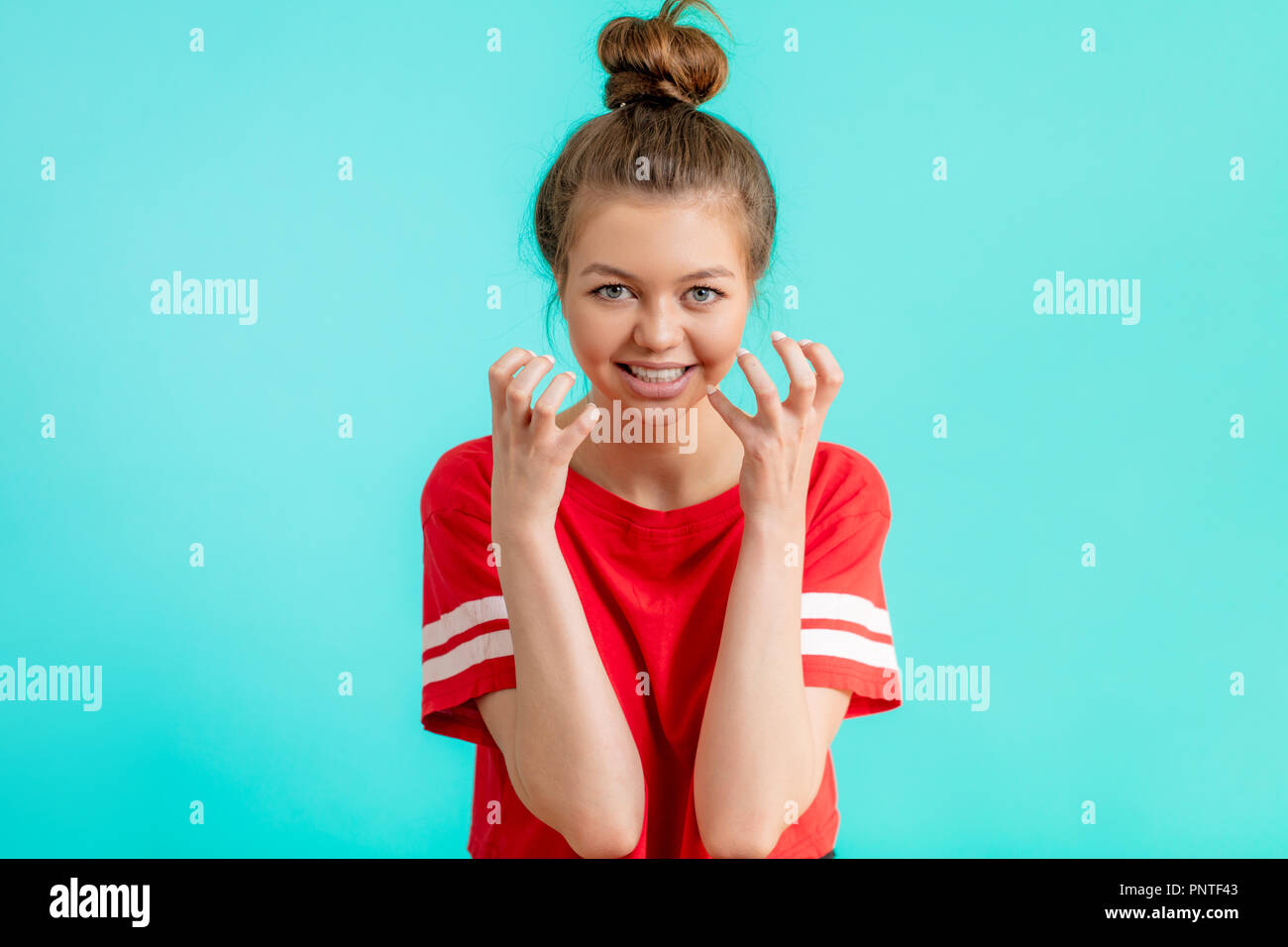 angry woman with crooked fingers - Stock Image