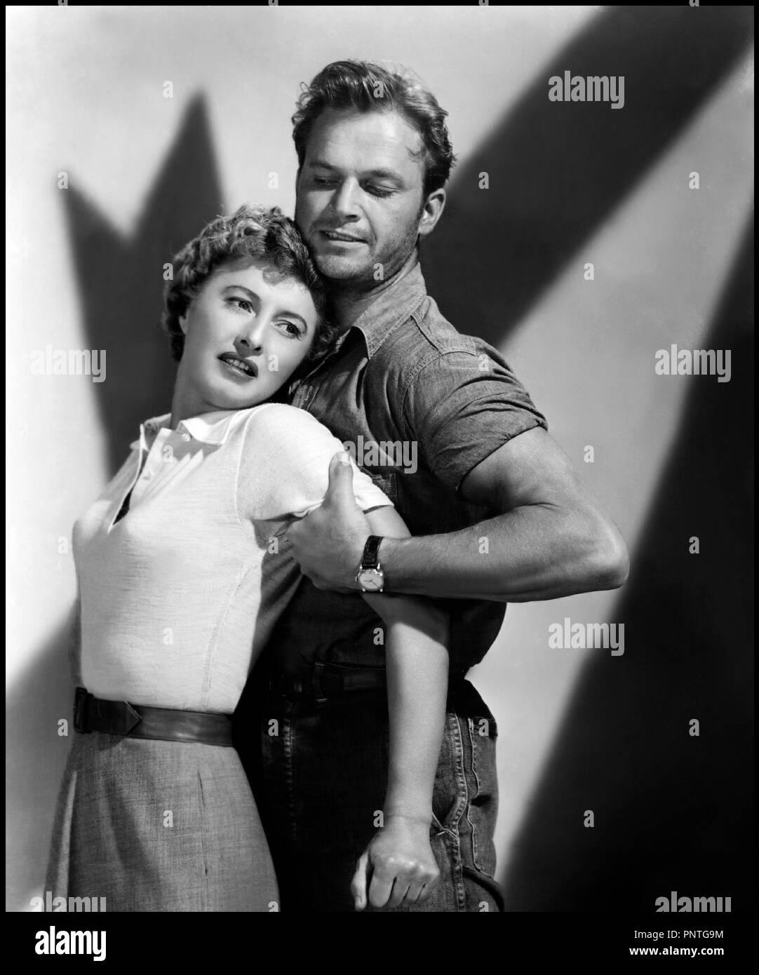 Prod DB © Loew's Inc. - Metro-Goldwyn-Mayer / DR LA PLAGE DESERTE (JEOPARDY) de John Sturges 1953 USA avec Barbara Stanwyck et Ralph Meeker  couple, pose, viol, femme battue, ombres, ambiance, film noir code MGM: 1594 - Stock Image