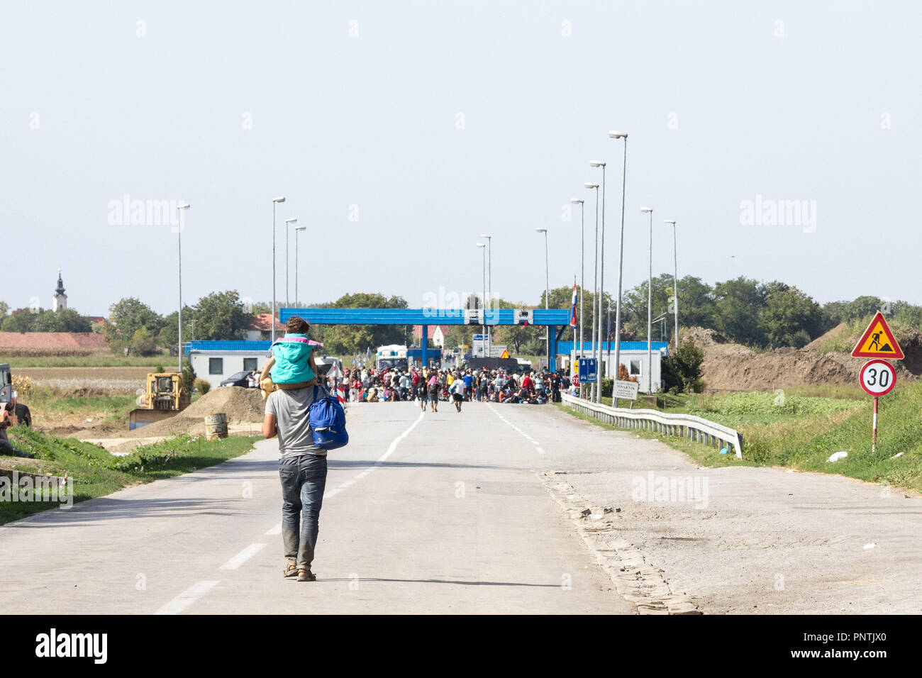TOVARNIK, CROATIA - SEPTEMBER 19, 2015: Refugees gathering in front of the Serbia-Croatia border crossing of Sid Tovarnik on the Balkans Route, during - Stock Image
