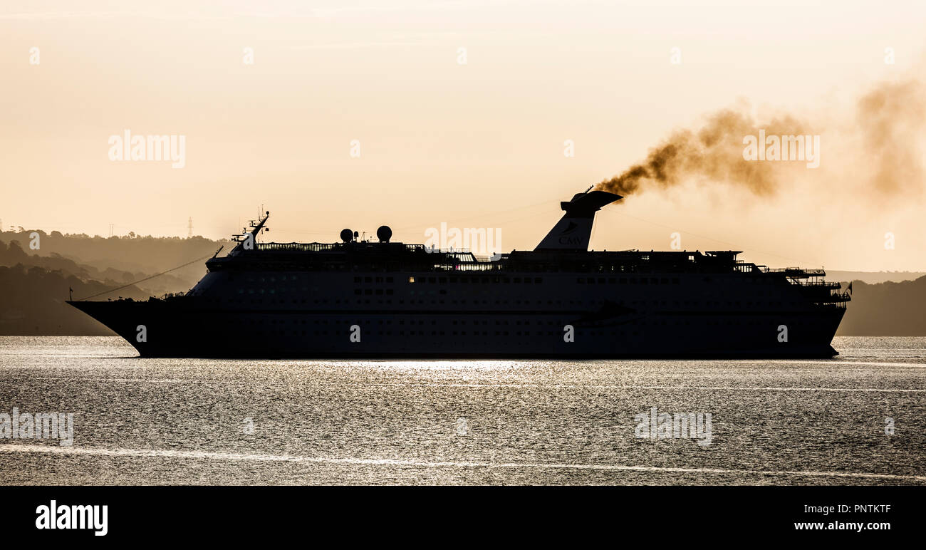 Cork, Ireland. 11th August, 2016.  cruise liner MS Magellan silhouetted by early morning sun asshe steams up Cork Harbour for a visit to Cobh. - Stock Image