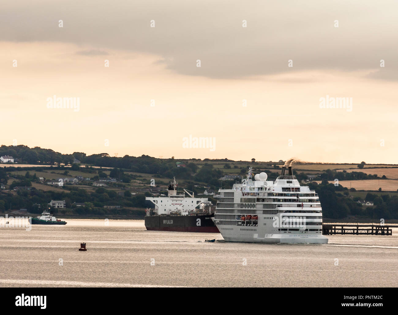 Whitegate, Cork, Ireland. 19th July, 2018. Cruise ship Seven Seas Navigator  passing the crude oil tanker Shah Deniz at Whitegate while on her way to  - Stock Image