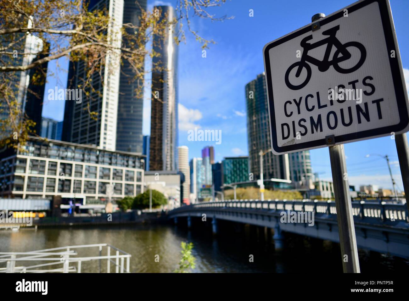 Cyclists dismount sign, Melbourne VIC, Australia Stock Photo