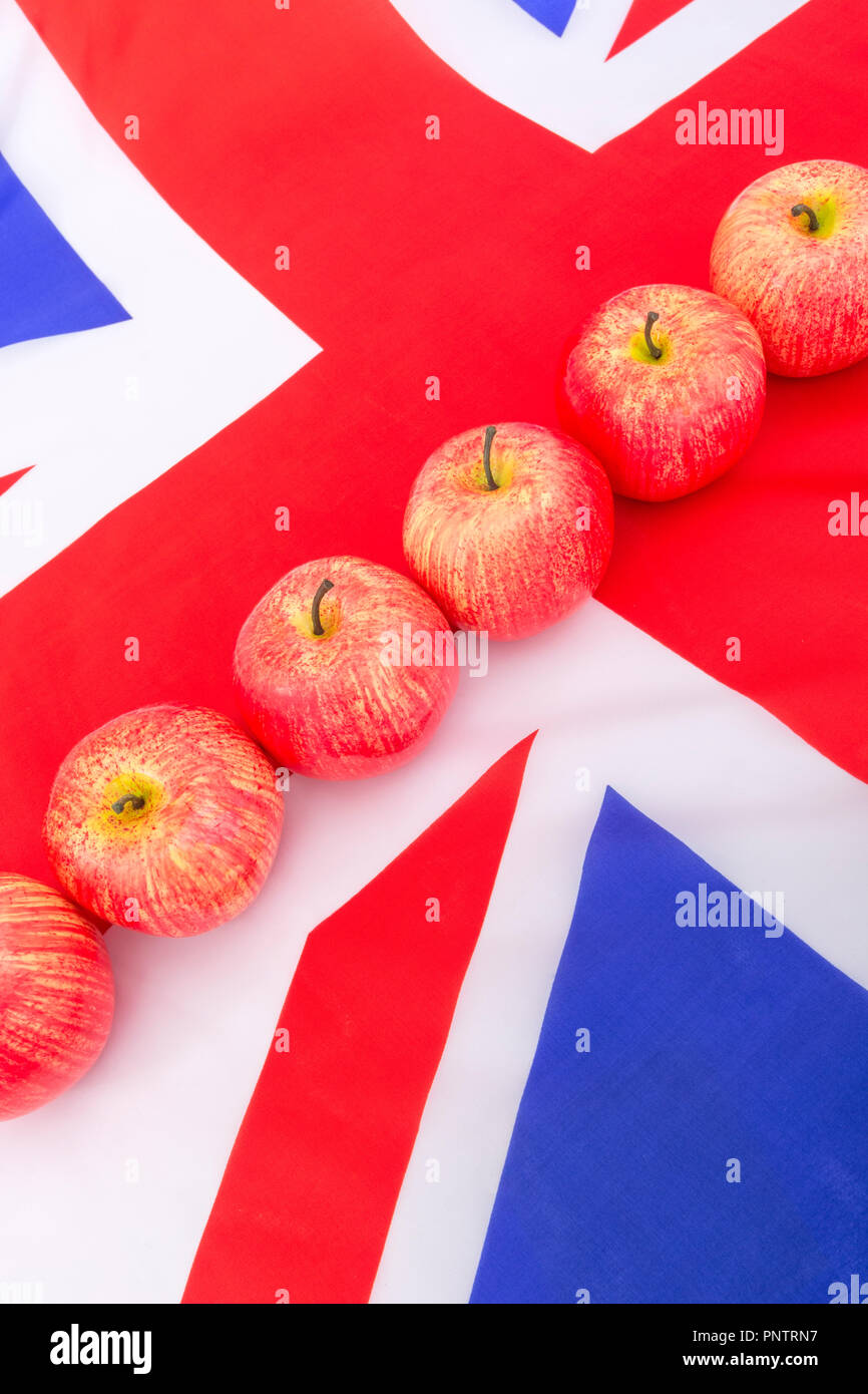 Red apples / apple with UK flag / Union Jack - metaphor for UK apple growing, English apples, UK British cider making industry, October Apple Day. - Stock Image