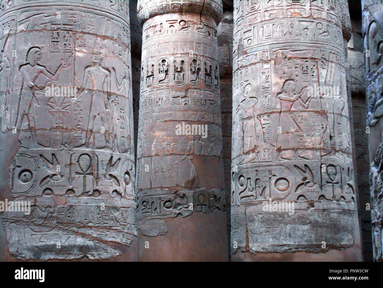 Pillars with hieroglyphics written on them at an ancient and historic site in Egypt. - Stock Image