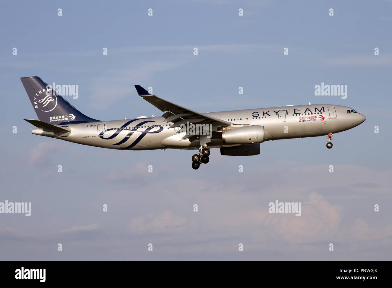 China Eastern Airlines Airbus 330-200 in Skyteam livery landing at Rome Fiumicino airport - Stock Image