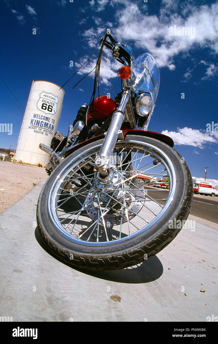 USA. Arizona, Kingman, Route 66. Low viewpoint close up of classic Harley-Davidson motorcycle. - Stock Image