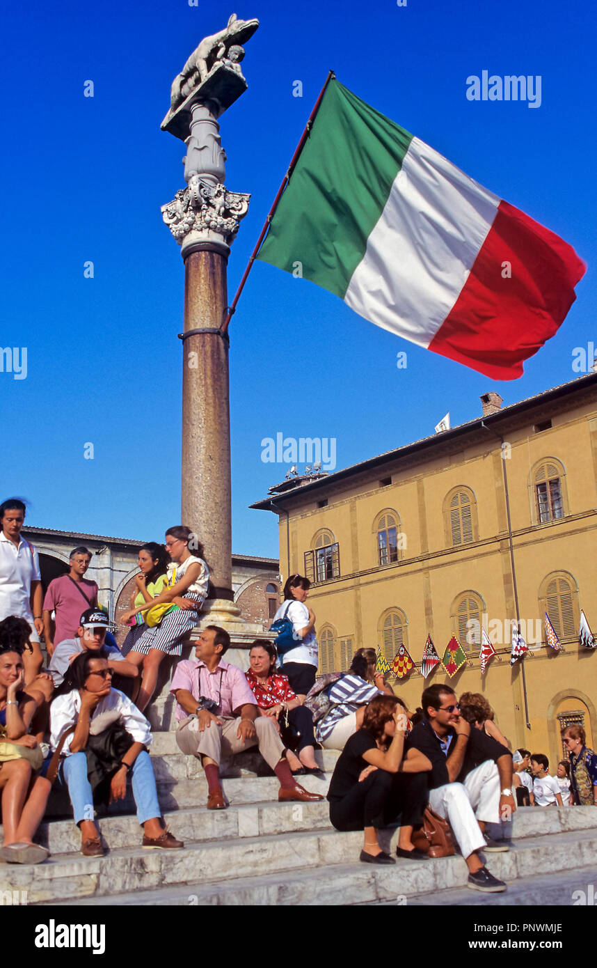 Urban view with tourists and flag. Siena. Italy. Europe Stock Photo