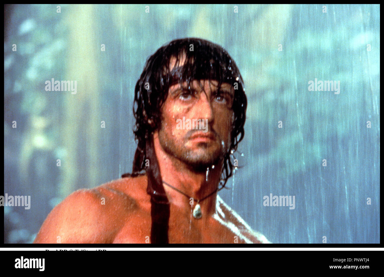 Prod DB © TriStar / DR RAMBO II (RAMBO : FIRST BLOOD PART II) de George P. Cosmatos 1985 USA avec Sylvester Stallone portrait, guerrier, pluie, - Stock Image