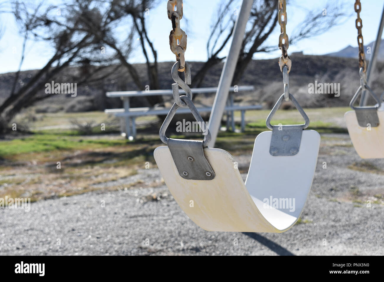 White Swing In An Abandoned Playground Stock Photo Alamy