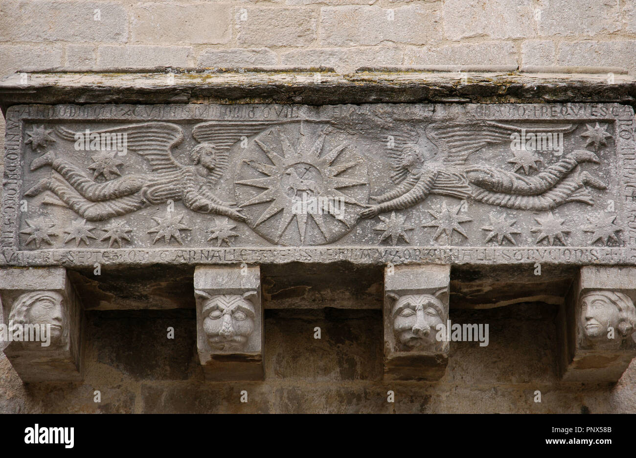 Early Christian Art. Spain. Catalonia. Girona. Collegiate Church of St. Felix. Replica of the sarcophagus which is kept inside the church. It belonged to the Sitjar family. Outside. Wall of the South Nave. On the front, there are two angels holding a circle with a Sun and the Agnus Dei inside. Stock Photo