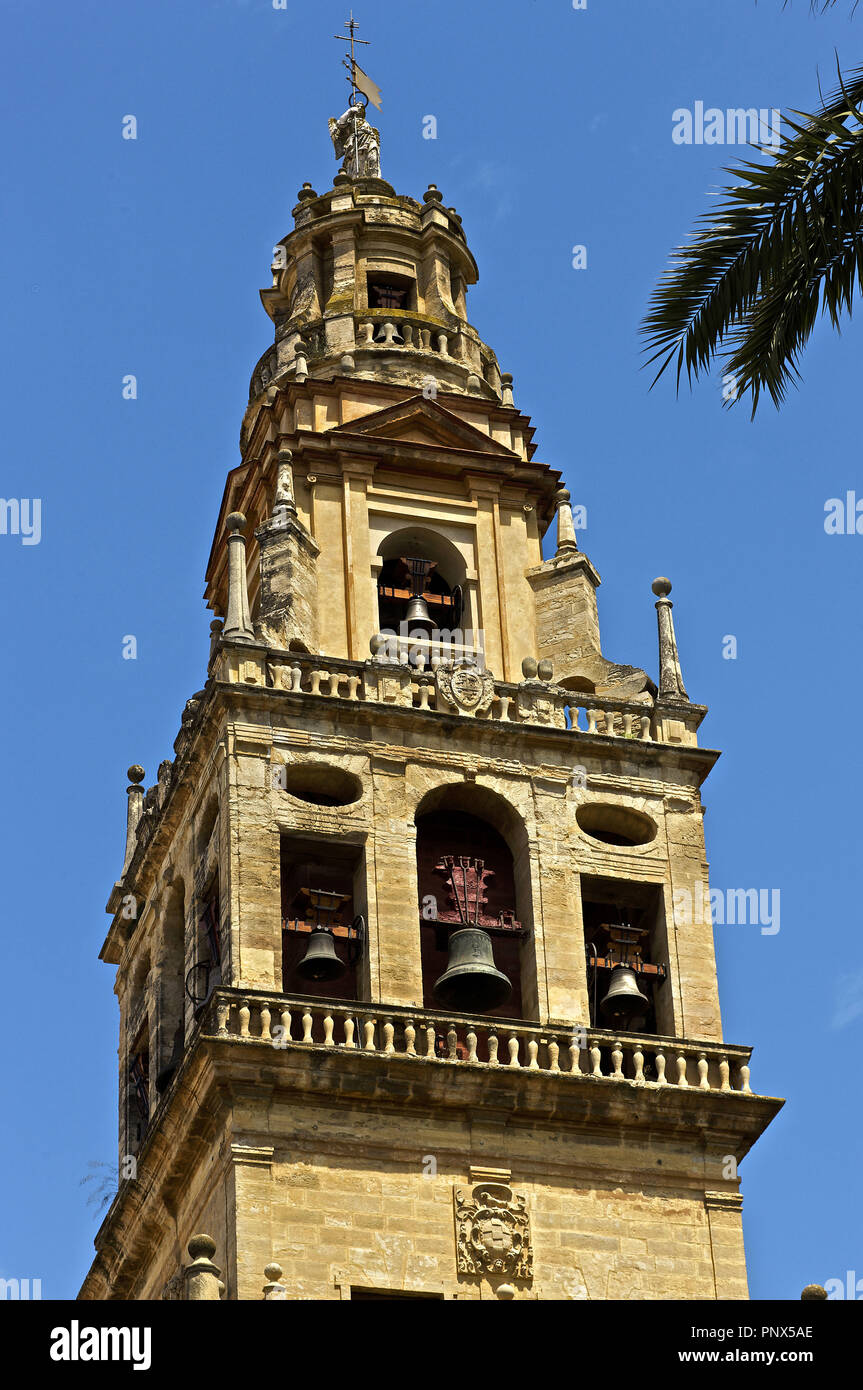 Spain. Andalusia. Cordoba. Bell tower of the Mosque-Cathedral. Built between 16th and 17th centuries by Hernan Ruiz III and Gaspar de Pena. Topped by a sculpture of Saint Raphael, designed by Pedro de la Paz and Bernabe Gomez del Rio. Stock Photo