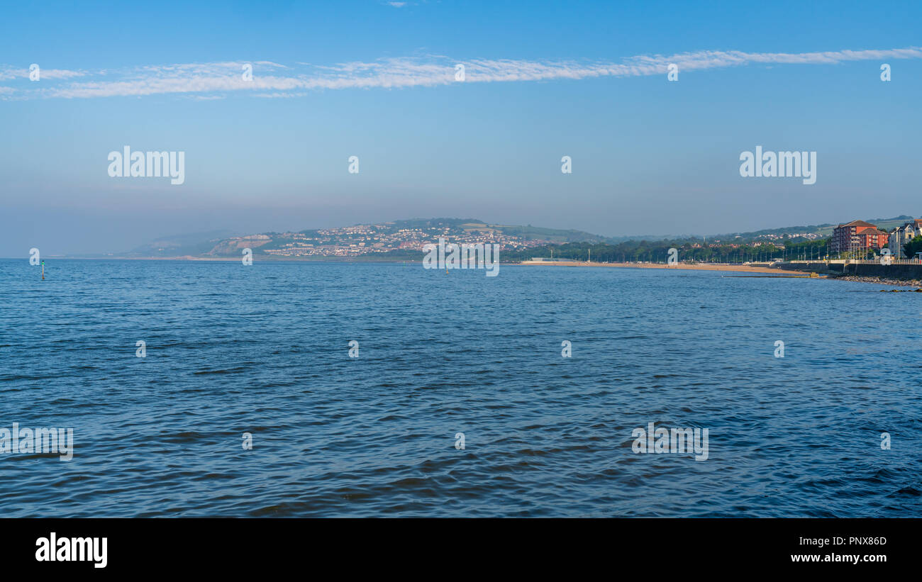Welsh coast in Rhos-on-Sea with Colwyn Bay in the background, Conwy, Wales, UK - Stock Image