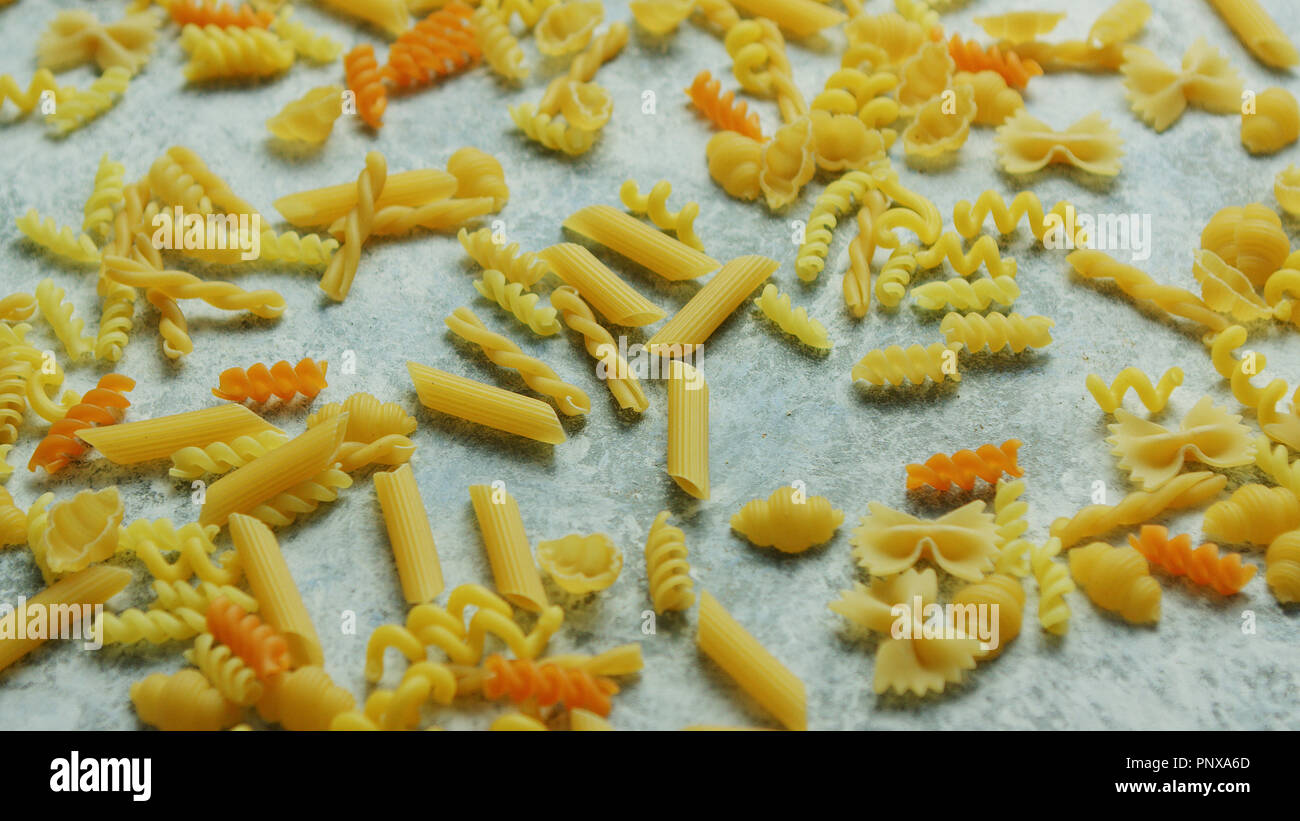 Different macaroni laid in disorder - Stock Image
