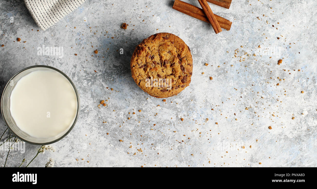 Glass of milk and cookie - Stock Image