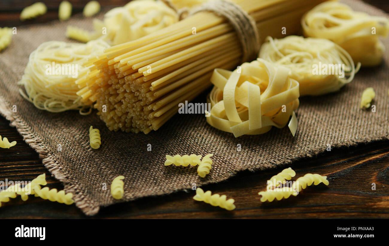 Spaghetti of different kind on napkin - Stock Image