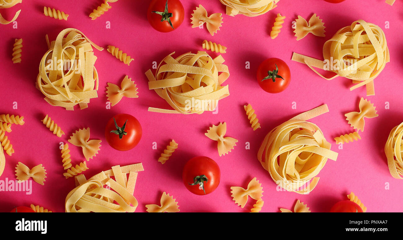 Layout of pasta and red tomatoes - Stock Image