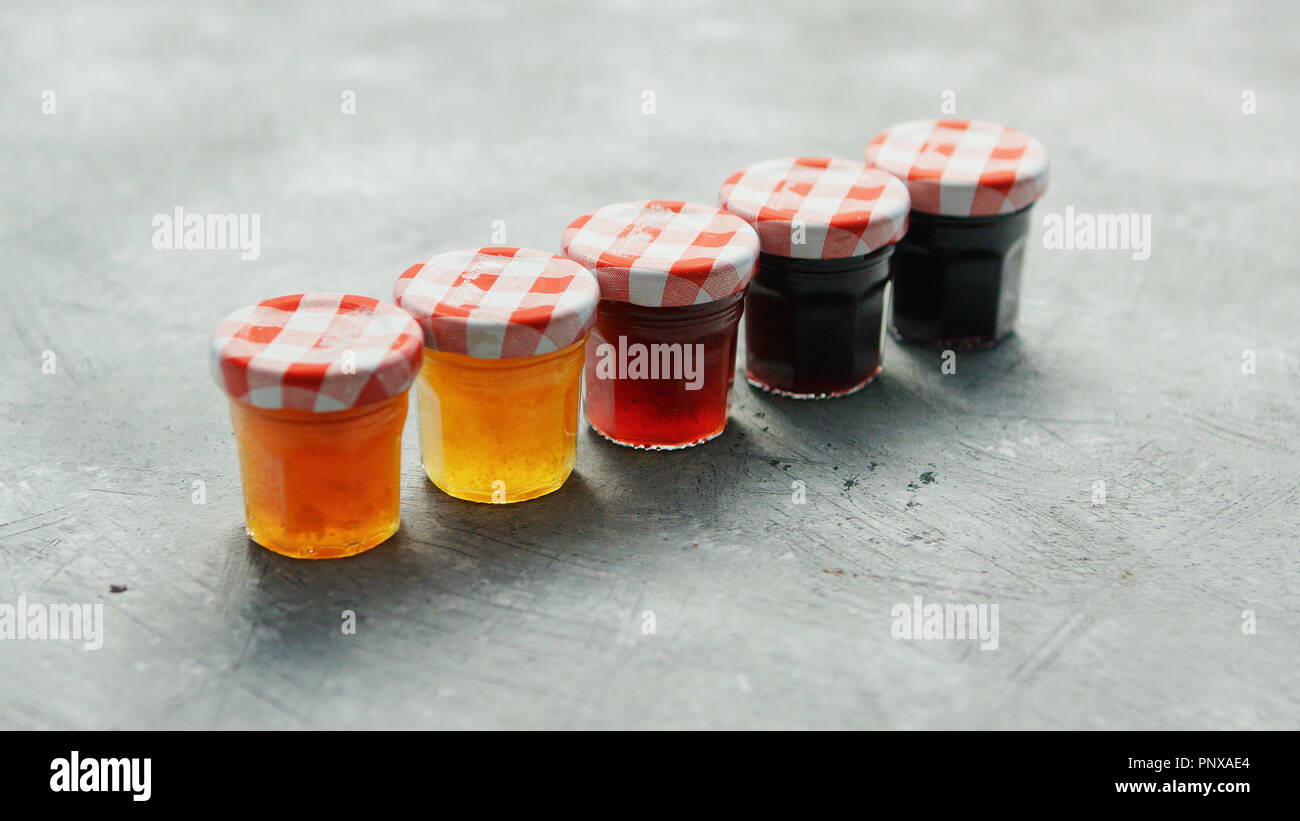 Small cups with different marmalade - Stock Image