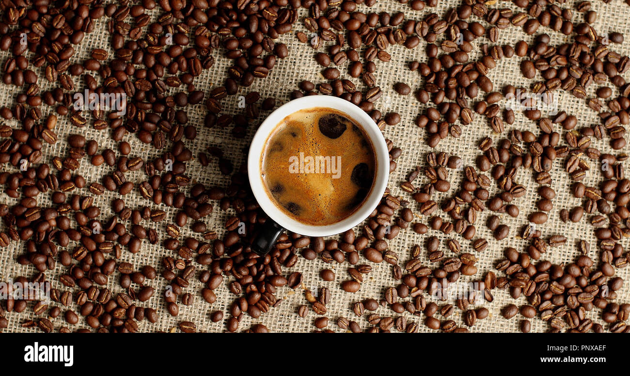 Cup of espresso and coffee beans - Stock Image