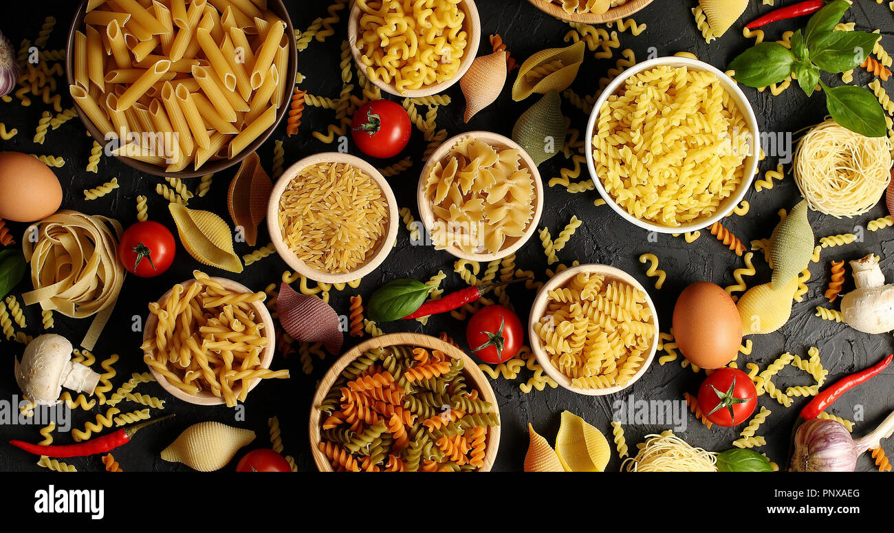 Layout of pasta and ingredients for cooking - Stock Image