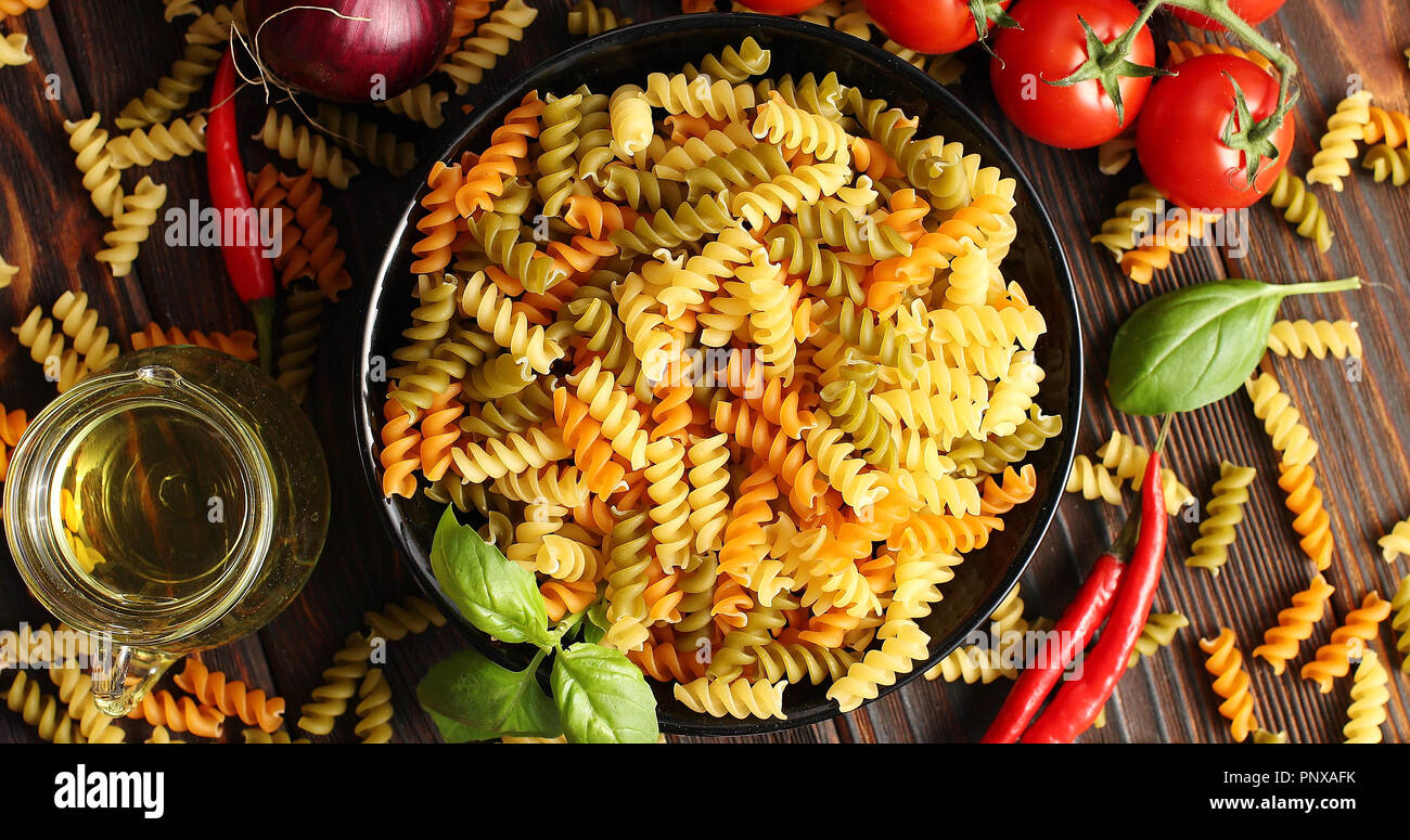Bowl of uncooked pasta from above - Stock Image