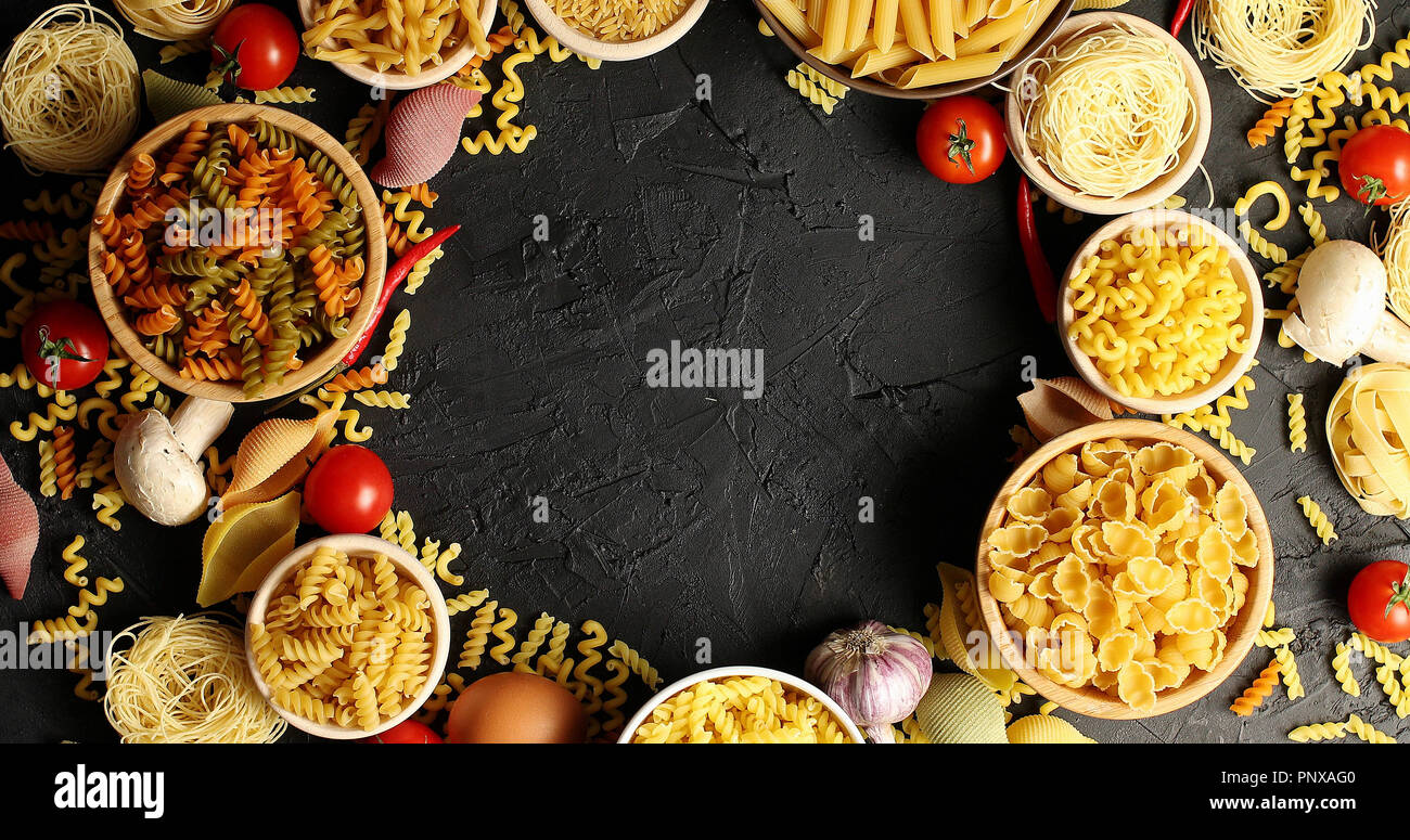 Arranged bowls with pasta assortment - Stock Image