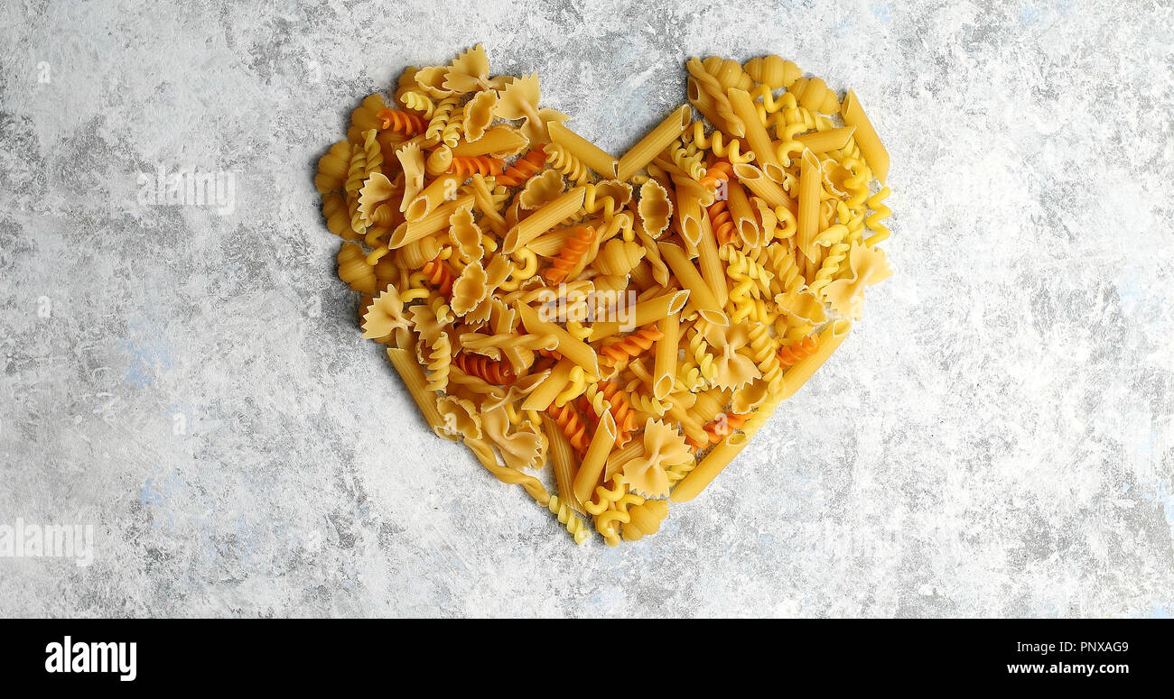 Heart shape made of pasta - Stock Image
