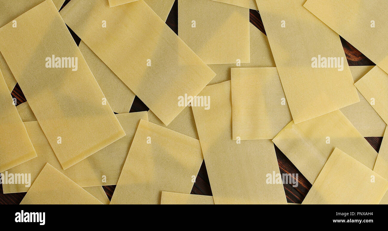 Heap of lasagna sheets on table - Stock Image