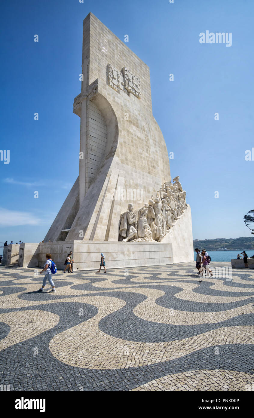 LISBON, PORTUGAL - August 30, 2018: Monument to the Discoveries (Padrao dos Descobrimentos) at the Tagus river with view on 25th of April Bridge - Stock Image